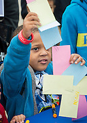 A student participates in a contest at the Deloitte booth at the When I Grow Up fair, March 8, 2014.