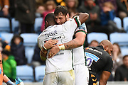 London Irish back row Albert Tuisue (8) celebrates victory with London Irish back row Ruan Botha (5) during the Gallagher Premiership Rugby match between Wasps and London Irish at the Ricoh Arena, Coventry, England on 20 October 2019.