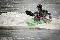 JEROME A. POLLOS/Press..Dave Turner paddles himself into position after flipping into the frigid water of the Spokane River.
