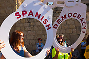 Spanish Democracy?<br /> During a pre referendum social event in Placa Octavia, Sant Cugat del Valles, with dancing and other traditional activities, including castellets, the human towers, pro independence activists question the actions of the Spanish government authorities following raids  companies, government offices and political parties, the arrest of politicians and activists and the confiscation of referendum materials from the Catalan independence movement. Ordinary people have started printing and distribution of posters and have taken to the streets in response. Spanish authorities have threatened more than 700 Catalan mayors including the mayor of Sant Cugat, politicians, school principals, and media with prosecution if they go ahead with the referendum.