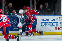 KELOWNA, CANADA - MARCH 3:  Conner Bruggen-Cate #20 of the Kelowna Rockets is checked in to the boards by Tyson Helgesen #6 of the Spokane Chiefs on March 3, 2018 at Prospera Place in Kelowna, British Columbia, Canada.  (Photo by Marissa Baecker/Shoot the Breeze)  *** Local Caption ***