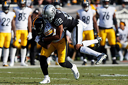 OAKLAND, CA - DECEMBER 09: Wide receiver James Washington #13 of the Pittsburgh Steelers is tackled by cornerback Rashaan Melvin #22 of the Oakland Raiders during the first quarter at the Oakland Coliseum on December 9, 2018 in Oakland, California. The Oakland Raiders defeated the Pittsburgh Steelers 24-21. (Photo by Jason O. Watson/Getty Images) *** Local Caption *** James Washington; Rashaan Melvin