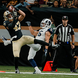 Aug 30, 2018; New Orleans, LA, USA; New Orleans Saints linebacker Alex Anzalone (47) intercepts a pass in front of Los Angeles Rams running back Nick Holley (25) during the first half of a preseason game at the Mercedes-Benz Superdome. Mandatory Credit: Derick E. Hingle-USA TODAY Sports