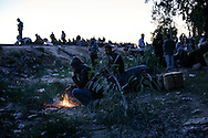 Egyptian migrant workers settle for an outdoor night  as they wait for repatriation after crossing the border into Tunisia in Ras Jdir.<br /> 25 February 2012.