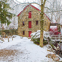 New England winter photography of the Sudbury Grist Mill at the Wayside Inn Historic District. This local New England landmark is in Sudbury, Massachusetts. <br />