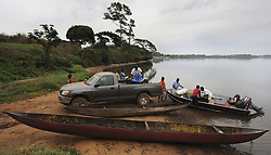 March 7, 2016 - Charlesville, Liberia - Liberian Chimpanzee Rescue caregivers load boat with food at the dock on March 7, 2016 in Liberia, West Africa. Foraging for the food takes a great deal of time.  The Humane Society of the United States and New York Blood Center came to an agreement recently in May 2017 after years of discussion about the care of research chimps that were abandoned by NYBC which withdrew all funding for food and water after decades of biomedical experimentation.  Their former caregivers used their own meager finances to continue feeding them. The Humane Society of the United States stepped in to improve the dire situation in which the chimps were literally left to die if not for the heroic efforts of their caregivers, former employees of NYBC who were abandoned as well. The chimps now live on six mangrove islands until funding can be provided for a true sanctuary. (Credit Image: © Carol Guzy via ZUMA Wire)