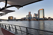 Southbank Riverwalk and city skyline along the St. John's River at sunset in Jacksonville, Florida.