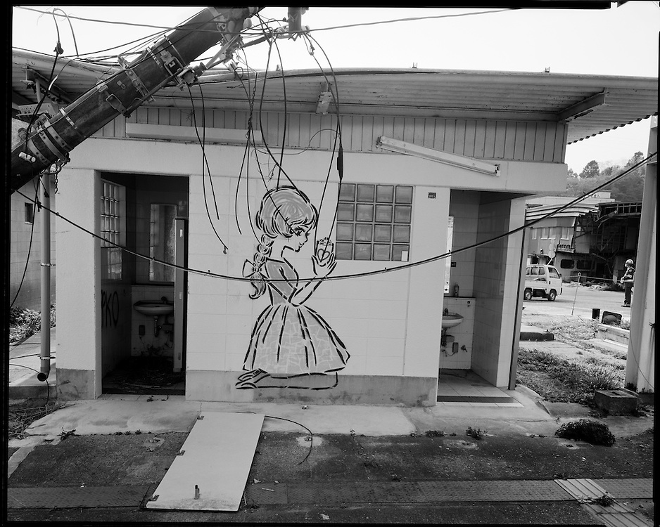 Public restroom at the  Tomioka railroad station in Fukushima destroyed by the  tsunami. For two years it was inside the 20km  exclusion zone  and has now (2015) been dismantled and  remains were disposed of as Nuclear waste.