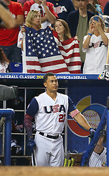 March 12, 2017 - Miami, FL, USA - United States right fielder Giancarlo Stanton looks from the dugout during the seventh inning of a World Baseball Classic first round Pool C game against Canada on Sunday, March 12, 2017 at Marlins Park in Miami, Fla. (Credit Image: © David Santiago/TNS via ZUMA Wire)