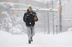Saturday, Jan. 22, 2016: West Virginia University college students play football on Beechurst Ave. in Morgantown, W.Va. after Winter Storm Jonas ripped through North Central West Virginia and dumped nearly 18 inches of snow. (Photo by Ben Queen)