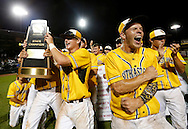 Southeast Polk players celebrate as they raise the championship trophy up to the stands Saturday, Aug. 1, 2015, after defeating Iowa City West in the 4A state finals at Principal Park in Des Moines.