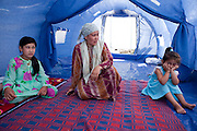 Since their home was torched in June, Dilbar Kasimova, 30, and her four children live in an UNHCR-provided tent on a street in Cheremushki District, Osh. At least 400 died and thousands more were injured in the ethnic violence. Most of the victims, like Kasimova, were Uzbeks...A mob killed the children's father, aunt and grandmother. The family keeps fragments of the grandmother's bones in a plastic shopping bag beneath a pile of scrap metal in the backyard, unsure where her final resting place shall be.