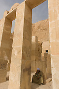 "A local guide at the ancient Egyptian Temple of Hatshepsut near the Valley of the Kings, Luxor, Nile Valley, Egypt. The Mortuary Temple of Queen Hatshepsut, the Djeser-Djeseru, is located beneath cliffs at Deir el Bahari (""the Northern Monastery""). The mortuary temple is dedicated to the sun god Amon-Ra and is considered one of the ""incomparable monuments of ancient Egypt."" The temple was the site of the massacre of 62 people, mostly tourists, by Islamists on 17 November 1997."