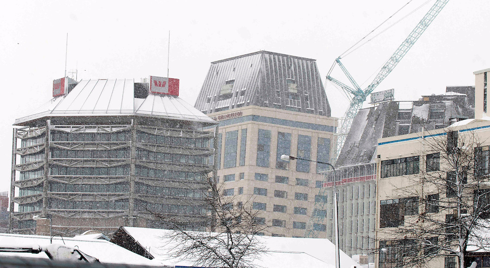 White in the red zone, snow falls on the Westpac Centre and Hotel Grand Chancellor, Christchurch, New Zealand, Monday, July 25, 2011. Credit:SNPA/David Alexander