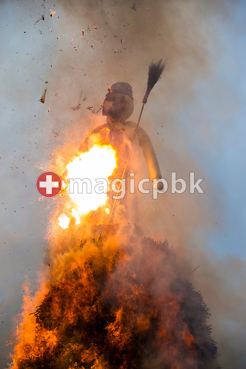 "The ""Boeoegg"" burns and explodes on the Sechselaeuten place in Zuerich, Switzerland, Monday, April 28, 2014. The Sechselaeuten (ringing of the six o'clock bells) is a traditional end of winter festival with a parade of guilds in historical uniforms on horseback and the burning of the Boeoegg, a symbolic snowman, at 6 pm. The faster the Boeoegg explodes, the hotter the summer will be according to traditional weather rules. (Photo by Patrick B. Kraemer / MAGICPBK)"