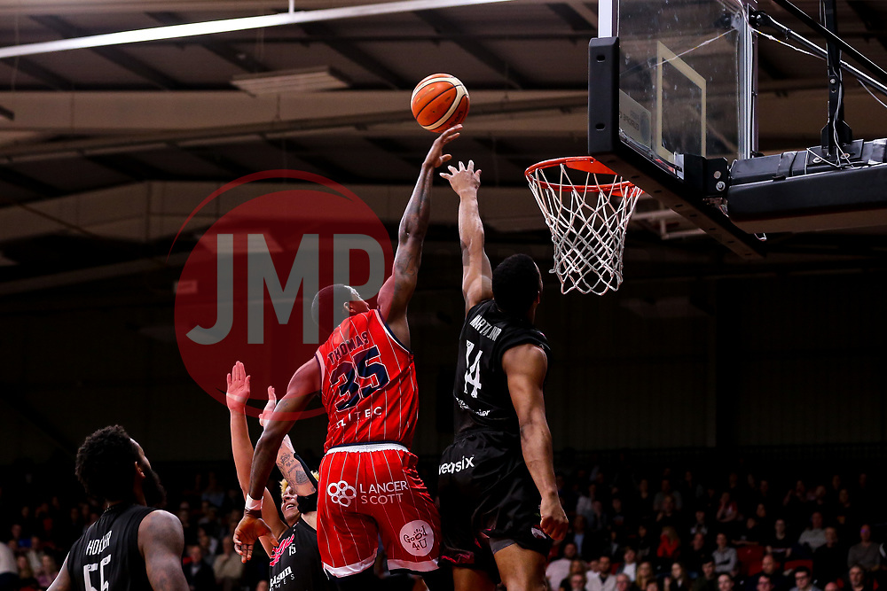 Fred Thomas of Bristol Flyers is blocked by Wayne Martin of Leicester Riders - Photo mandatory by-line: Robbie Stephenson/JMP - 11/01/2019 - BASKETBALL - Leicester Sports Arena - Leicester, England - Leicester Riders v Bristol Flyers - British Basketball League Championship