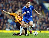 Photo: Scott Heavey. Digitalsport<br /> Chelsea v Wolverhampton Wanderers. FA Barclaycard Premiership. 27/03/2004.<br /> Frank Lampard evades a sliding tackle from Alex Rae