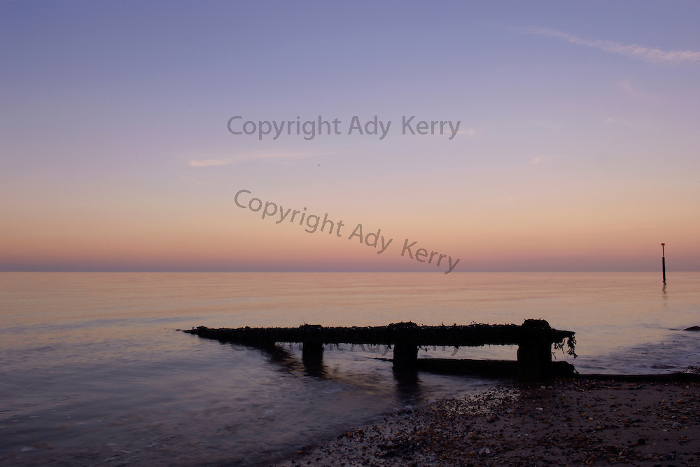 A groyne on the beach at Reculver, near Herne Bay, Kent, as the sunsets, 6th November 2006