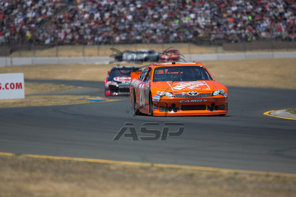 SONOMA, CA - JUN 24, 2012:  Joey Logano (20) brings his car through the turns during the Toyota Save Mart 350 at the Raceway at Sonoma in Sonoma, CA.