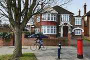 © Licensed to London News Pictures. 07/04/2013. London, UK A woman cycles past the embassy. The North Korean Embassy in Ealing in West London today, 7th April 2013. The Embassy is based in a 1920's detached house in a residential area. Photo credit : Stephen Simpson/LNP