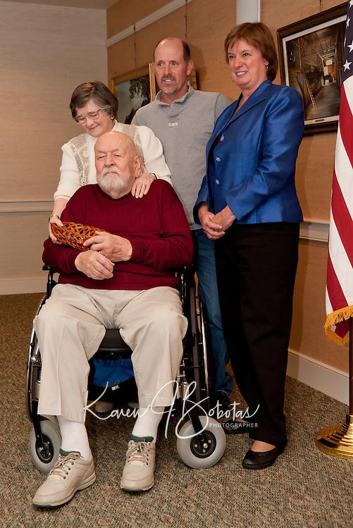 Herbert Gray receiving medals of honor from Carol Shea-Porter October 18, 2010.