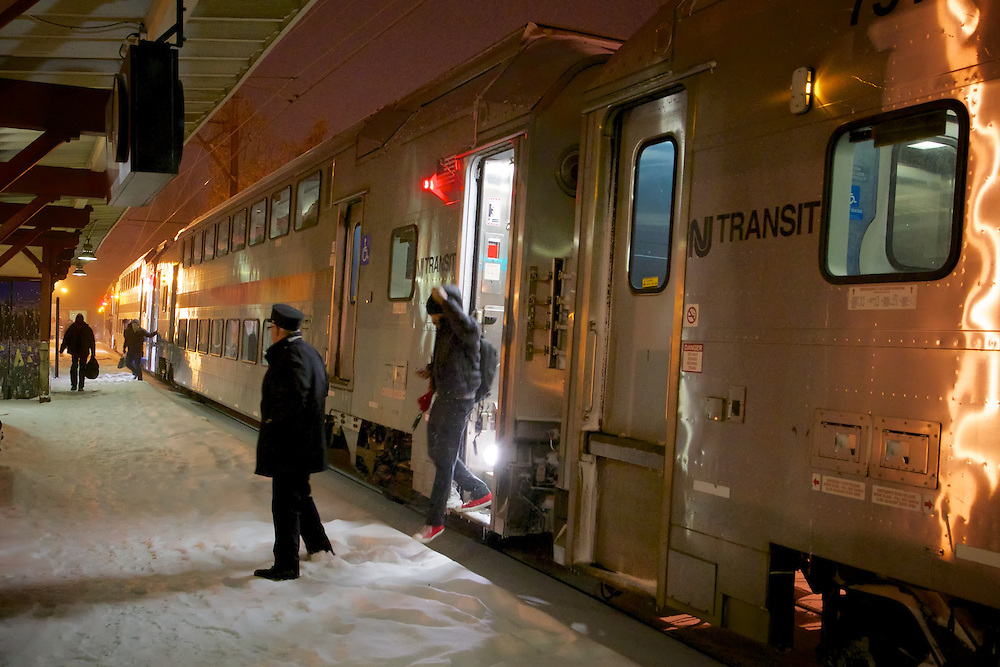Leaving the warmth and security of the train, travelers disembark at  Maplewood to continue their journey home through the falling snow.