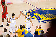 Golden State Warriors guard Klay Thompson (11) and Golden State Warriors guard Stephen Curry (30) celebrate against the Houston Rockets during Game 6 of the Western Conference Finals at Oracle Arena in Oakland, Calif., on May 26, 2018. (Stan Olszewski/Special to S.F. Examiner)
