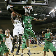 Central Florida guard/forward Isaiah Sykes (32) attempts a shot against Marshall center Nigel Spikes (11) during a Conference USA NCAA basketball game between the Marshall Thundering Herd and the Central Florida Knights at the UCF Arena on January 5, 2011 in Orlando, Florida. Central Florida won the game 65-58 and extended their record to 14-0.  (AP Photo/Alex Menendez)