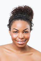 Beauty portrait of smiling young African American woman over white background