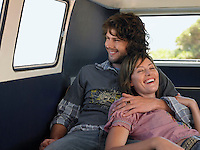 Young couple embracing in back of van