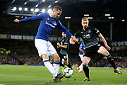 Everton midfielder Gylfi Sigurosson (10) crosses despite the attention of Burnley defender Ben Mee (6) during the Premier League match between Everton and Burnley at Goodison Park, Liverpool, England on 3 May 2019.