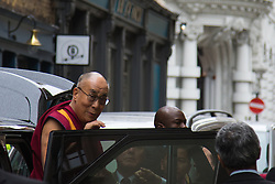 "London, September 21st, 2015. The Dalai Lama, who is on a visit to Britain, arrives amid anti-discrimination protests by Shugden Buddhists, at the Lyceum Theatre in Covent Garden to host ""An Afternoon with the Dalai Lama and Friends""."