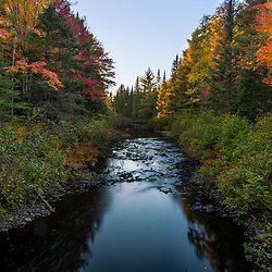 Fall foliage and Soldier Brook in Maine's Northern Forest.