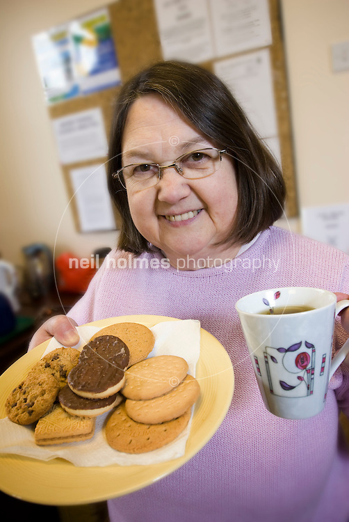 Mary Young, serving teas and coffees in the village hall.
