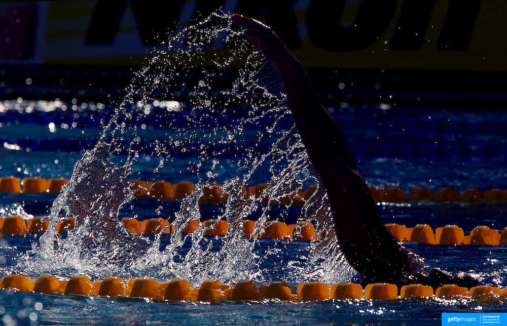 A swimmer trains before competition in the early morning light  at the World Swimming Championships in Rome on Sunday, July 26, 2009. Photo Tim Clayton.