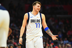 December 21, 2018 - Los Angeles, CA, U.S. - LOS ANGELES, CA - DECEMBER 20: Dallas Mavericks Guard Luka Doncic (77) looks on during a NBA game between the Dallas Mavericks and the Los Angeles Clippers on December 20, 2018 at STAPLES Center in Los Angeles, CA. (Photo by Brian Rothmuller/Icon Sportswire) (Credit Image: © Brian Rothmuller/Icon SMI via ZUMA Press)