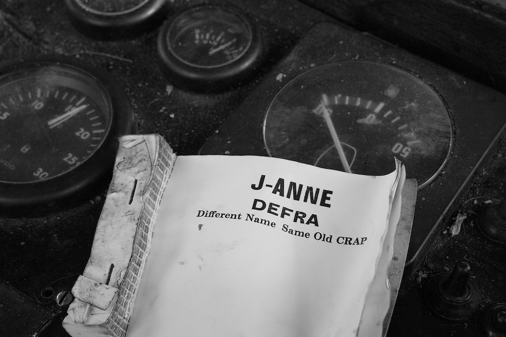 Mick's notebook aboard his 29 foot trawler 'J-Anne', displaying his feelings about DEFRA.<br /> <br /> 'Grimmy' has been a fisherman for 41 years, starting his career from his home port of Grimsby, working off Iceland, Greenland and the White Sea, during the time when the UK cod fleet was being ousted from North Atlantic waters. <br /> <br /> Having fished out of Newlyn for 27 years, he feels that he is now being 'economically kicked out of his own waters' and that the UK fishing industry is being selectively destroyed by the Common Fisheries Policy that is run from Brussels. <br /> <br /> Mick says 'There is no future for our fishing industry while Brussels is in charge and while priorities are more politics than fish conservation'. <br /> <br /> In 2004, as part of the 'Save British Fish Campaign' he spent 22 days sailing his boat around the south and south east coast, stopping at 17 ports on his way to Traitors Gate at the Tower of London, aiming to hand over copies of each EU treaty signed by the UK, although he was prevented from doing this. <br /> <br /> 'We've got the richest fishing grounds in the world around our coasts and we've got a declining industry.  There's something wrong somewhere and I blame Europe.  It's Brussels that's destroyed my living'.<br /> <br /> UPDATE:<br /> He has now retired from fishing and his beloved J-Anne scrapped. <br /> One of his last acts of defiance was to illegally land his over-quota fish and give it away to the elderly rather than throwing back into the sea dead or dying, which the law requires him to do.