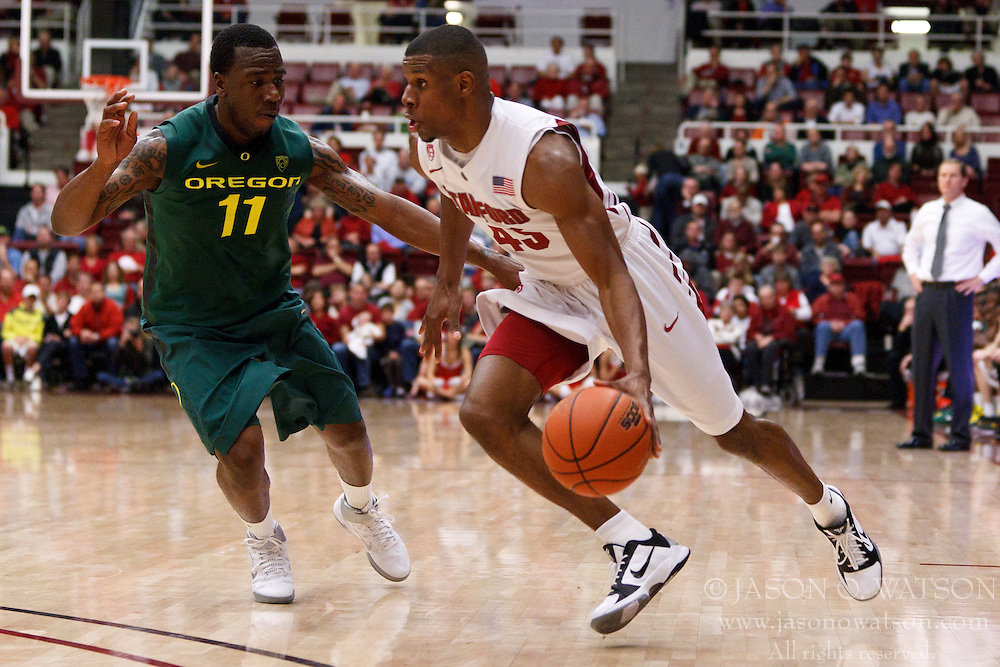 January 27, 2011; Stanford, CA, USA;  Stanford Cardinal guard Jeremy Green (45) is defended by Oregon Ducks guard Malcolm Armstead (11) during the second half at Maples Pavilion.  Oregon defeated Stanford 67-59.