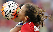 Feb 21, 2016; Houston, TX, USA; Canada forward Christine Sinclair (12)  and USA midfielder Carli Lloyd (10) head the ball in the second half during the 2016 CONCACAF women's Olympic soccer tournament at BBVA Compass Stadium. USA won 2 to 0. Mandatory Credit: Thomas B. Shea-USA TODAY Sports