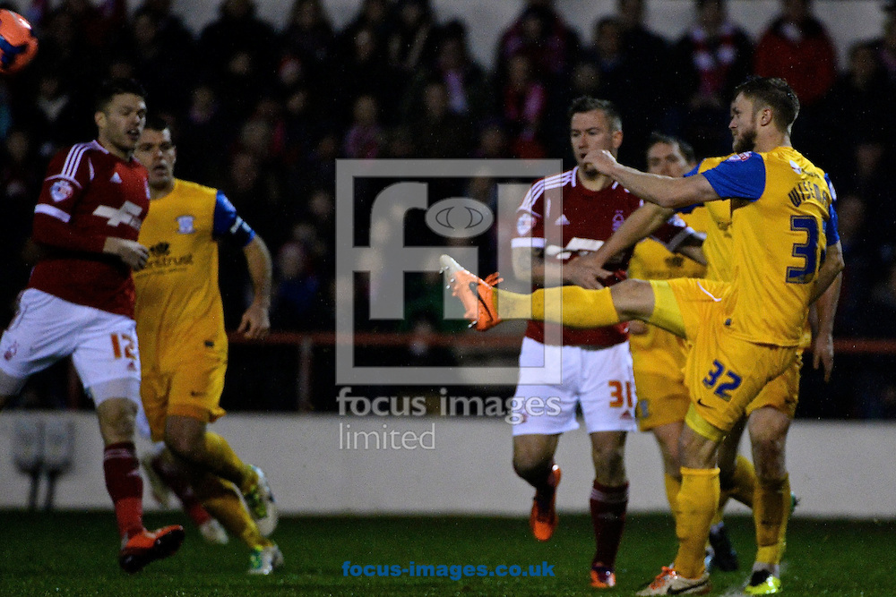 Picture by Ian Wadkins/Focus Images Ltd +44 7877 568959<br /> 24/01/2014<br /> Scott Wiseman of Preston North End clears during the The FA Cup match at the City Ground, Nottingham.