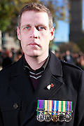 Why have you come and why are you wearing the poppy?<br /> <br /> &quot;I am here remembering friends.&quot; <br /> Mark Davies<br /> <br /> Crowds gather in central London on Remembrance Sunday and on the Monday morning to mark the 11th hour.<br /> <br /> Picture by Zute Lightfoot