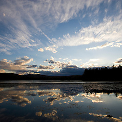 Clouds reflect in Robb Reservoir in Stoddard New Hampshire USA