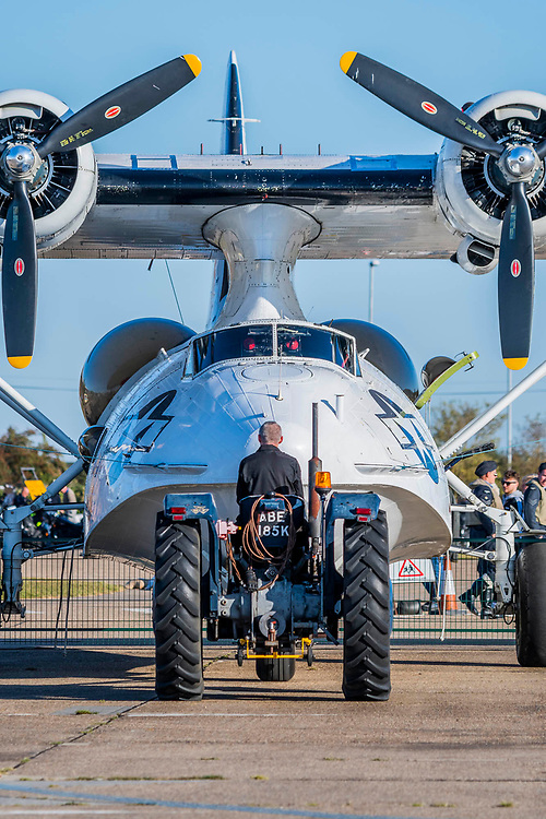 A Consolidated PBY-5A Catalina flying boat is moved into position - Duxford Battle of Britain Air Show at the Imperial War Museum. Also commemorating the 50th anniversary of the 1969 Battle of Britain film. It runs on Saturday 21 & Sunday 22 September 2019