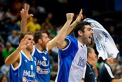 Players of Greece celebrate during basketball game between National basketball teams of Slovenia and Greece at FIBA Europe Eurobasket Lithuania 2011, on September 8, 2011, in Siemens Arena,  Vilnius, Lithuania. Greece defeated Slovenia 69-60.  (Photo by Vid Ponikvar / Sportida)