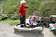 Georgia, Georgian military Highway, Jvaris Ughelt (Cross Pass) 2379 M elevation local woman sells handmade souvenirs to tourists