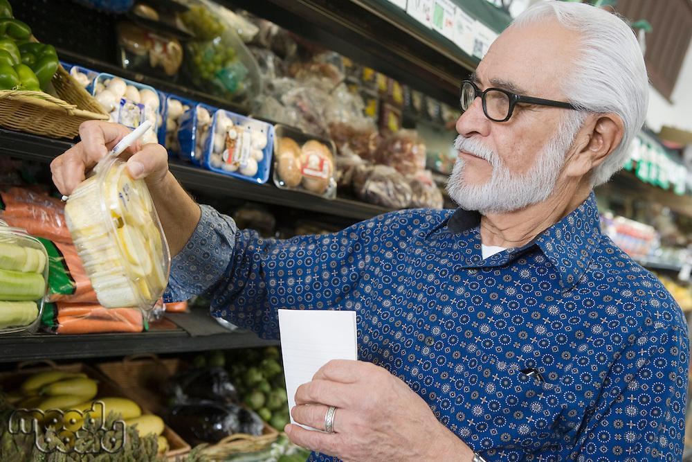 Elderly man vegetable shopping