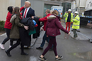 The waxwork of Donald Trump is carried to the US Embassy at Nine Elms in south London on the day when the President announced on Twitter, his refusal to visit London and open the new state premises after its historic move from Grosvenor Square, on 12th January 2018, in London, England. The waxwork is the property of Madame Tussauds and took a team of 20 artists 4 months to create, going on display on the day of his inauguration in 2017. It is valued at £150,000.