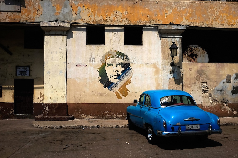 Two ubiquitous symbols of Cuba, an image of Che Guevara and a vintage car, are paired together on a street in Old Havana.  (David Albers/Staff)