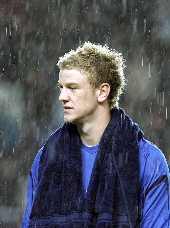 England goalkeeper Joe Hart lines up in the rain  for the national anthem with a towel around his neck. England v Republic of Ireland, Uefa Under-21 Championship Qualifier, Tuesday 5th February 2008, St Marys, Southampton.