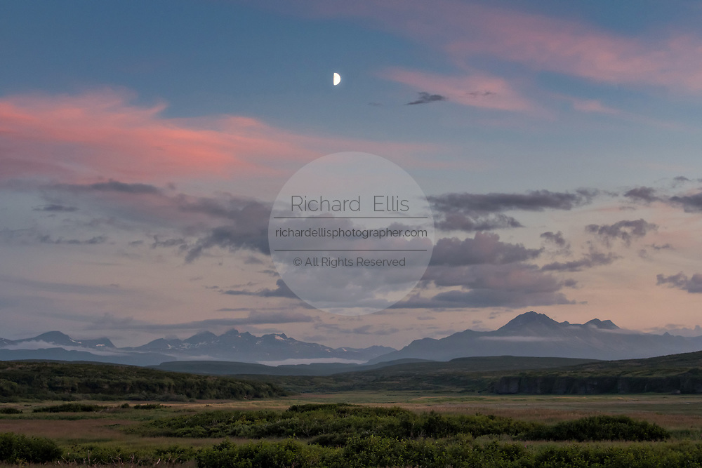Moon rise over the Chigmit Mountains at the McNeil River State Game Sanctuary on the Kenai Peninsula, Alaska. The remote site is accessed only with a special permit and is the world's largest seasonal population of brown bears in their natural environment.